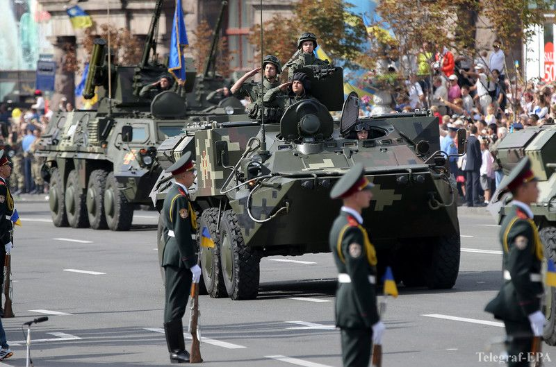 epa04365741 Ukrainian APCs (Armoured Personnel Carriers) drive on Kiev's Independence Square in downtown Kiev, Ukraine, 24 August 2014. Ukraine marked its Independence Day with a big military parade in the capital , as the bloody pro-Russian separatist rebellion continued in the east of the country. The Kiev parade, attended by President Petro Poroshenko, included hundreds of Ukrainian troops and displayed of military hardware. It marked the 23rd anniversary of Ukraine's independence from the Soviet Union, in 1991. EPA/TATYANA ZENKOVICH